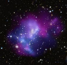 Galaxy Cluster MACS J0717: This composite image shows the massive galaxy where four separate galaxy clusters have been involved in a collision. Hot gas is shown in an image from NASA's Chandra X-ray Observatory, and galaxies are shown in an optical image from NASA's Hubble Space Telescope. The hot gas is color-coded to show temperature, where the coolest gas is reddish purple, the hottest gas is blue, and the temperatures in between are purple.  Lies approx. 5.4 billion light years from…