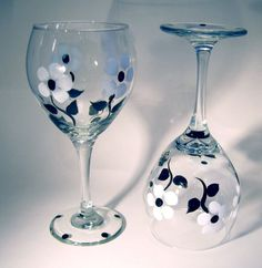 Black and White Floral Painted Wine Glasses on the black stemmed wine glass