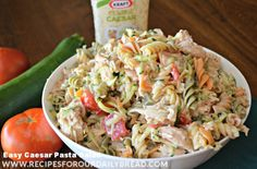 Caesar Chicken Pasta Salad with bacon, tomatoes, zuchinni, and cheese.