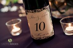 Customized wine bottles serve as table numbers | Lasting Images Photography | villasiena.cc
