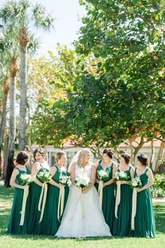 White, Gold and Green Old Florida Inspired Wedding Party Outdoor Garden Portrait, Bridesmaids in Watters Dresses, Bride in V Neck Morilee by Madeline Gardner Wedding Dress, with White Floral Bouquets with Greenery and Long Gold Ribbons | Tampa Bay Wedding Photographer Ailyn La Torre Photography