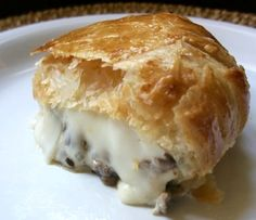 Baked Mushroom-Stuffed Brie en Croute - FABULOUS!  I added 2 tbsp of white wine to the sautee, made the rest as is.  SO good!