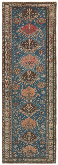 Caucasian Soumac, 3ft 6in x 10ft 3in, Circa 1875.  Instead of hand knotting, the design of this mesmerizing Caucasian short runner is created using the incredibly durable Soumac embroidery technique. In addition to the crystal clear definition of its motifs this elegant 19th century geometric Oriental rug offers an incomparable marine blue field tone that instantly captivates its viewer. A wealth of supporting exotic hues add to its great beauty and magnetism.