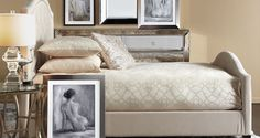 Clean lines, monochromatic hues and mirrored panels create a sophisticated and romantic bedroom space.