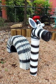 What a Zebra! This Zebra was created with an old tire and PVC. After scrubbing the tire clean to use as the main body, we managed to use one last recycled piece of PCV for the neck and head! I want to do this with a few tires to make a dragon! Kids Outdoor Play, Outdoor Play Areas, Kids Play Area, Garden Crafts, Garden Projects, Garden Art, Garden Ideas, Tire Playground, Outdoor Playground