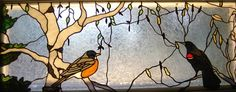 stained glass birds robin red wing blackbird