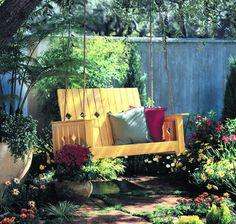 Regardless of the fact that you don't have a back yard , you can at present change your patio into a fun outdoor place to unwind and it won't cost so much. This patio is loaded with reused things. The old table and seat have been given another lease of life together with the table produced using reused pallet wood. You can even leave space for growing vegetables and with the overhanging plants you will have a wealth of food.
