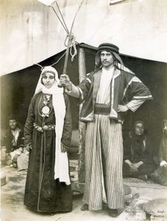 """Bedouin bride and groom."" (Bedouin woman and man in the Streets of Cairo section of the Pike at the 1904 World's Fair)."