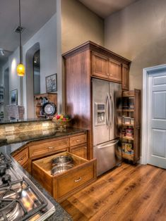 Lovely kitchen. cabinets, lighting, pull-out pantry around fridge