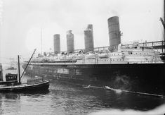 Lusitania alongside at the Cunard Pier at New York, date unknown.