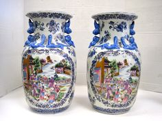 Hand painted set of matching blue and white Japanese large urns.