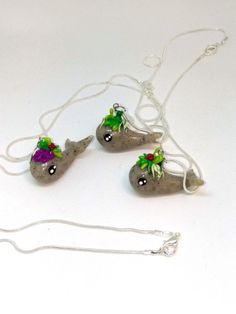 This cute little whale is made with granite looking clay topped with your favorite succulents. The chain is Sterling Silver and 16 long. This charm is made entirely out of polymer clay.