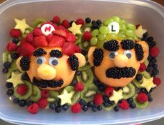 Mario and Luigi made this for my sons 4th birthday fruit strawberries grapes raspberries blueberries pineapple cantaloupe kiwi blackberries delicious and nutritious :)