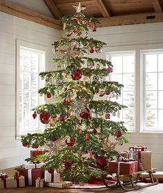 These treasures for your tree are blown of mercury glass with an antique champagne or silver finish, then topped with a bronze-finished cap and hung from a natural jute string.
