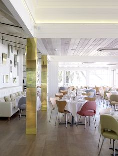 Love the varied colors on the ceiling wood planks. Stokehouse Restaurant in Australia, design by Pascale Gomes-McNabb.