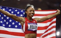United States' Allyson Felix celebrates winning gold in the women's 200-meter final during the athletics in the Olympic Stadium.  (Photo: Ben Curtis / Associated Press) #NBCOlympics