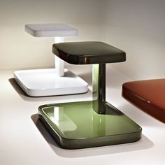 The fabulous Piani lamp from Flos can be ordered from us in the colours shown here, as well as black and white. It's made from ABS - the same stuff used to make Lego - so it's strong and sturdy. Please ask us for more info, http://www.italian-lighting-centre.co.uk/modern-plastics-lamps/piani-table-lamp-with-tray-colours-from-flos-p-7377.html#.VPIhYy42VL8