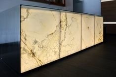 Backlit white onyx reception desk at 680 Folsom in San Francisco, California.