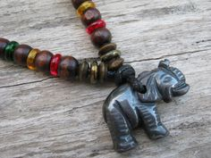 Rasta Elephant Necklace Hematite Elephant by Abundantearthworks  #elephant #elephantnecklace #elephantjewelry #hematite #hematitenecklace #rasta #rastanecklace #haileselassie #jamaica #ethiopia #reggae #gemstone #adjustablenecklace #unisexjewelry #mensgift #tribal #surfer #abundantearthworks