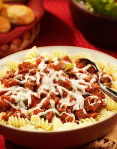 Sausage and Tomato combine into perfection with this easy Rotini weeknight dinner recipe!