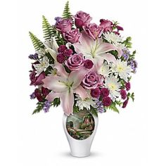 Same Day Flowers Delivery:  A graceful celebration of life's special moments, this lush bouquet of #lilies and #roses is like a soothing walk through a beautiful garden.