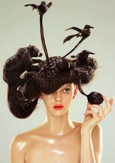 check out these wild looking hats made completely out of hair by japanese artist, Nagi Noda