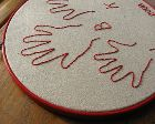 How to embroider a child's hand print