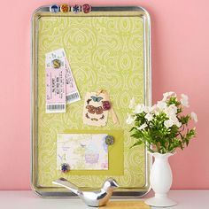 Memo boad. Cut out pretty craft paper and glue it into the bottom of a  new baking pan. Voila! use magnets to put up notes and memos.