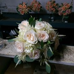 Bridal bouquet of garden roses, hydrangea, eucalyptus and roses...