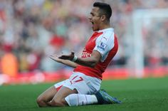 Alexis Sanchez celebrates scoring the third Arsenal goal