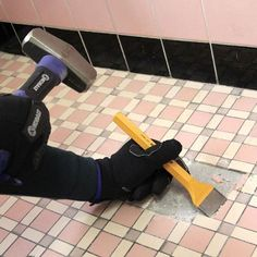 Planning on remodeling your bathroom? We'll show you how to remove old tile with a chisel.