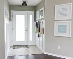 Light gray walls, white trim, dark floors.--identical to our home; love the white frames to bring light in.