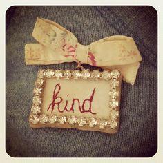 'kind' word brooch: Julie Arkell