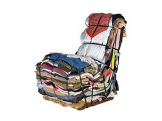Olds rags and clothes made into a chair: Finally a solution for all that LAUNDRY! hahaha