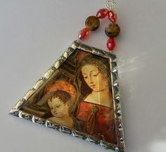 Madonna and Child Christmas ornament soldered in beveled glass with quartz…