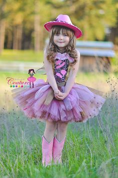 This fabulous diva cowgirl tutu dress is done in tones of pink, brown and gold. Very detailed one of a kind costume, no one will look like