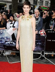 Anne Hathaway, wearing Gucci and Tiffany