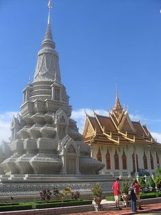 Phnom Penh is the capitol of Cambodia.  It is very detailed and very beautiful. Silver stupa and the royal palace - Phnom Penh, Cambodia