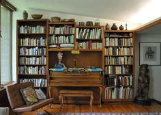 Build shelves around piano in the alcove