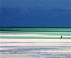 walking in the Zanzibar sands    Nungwi beach, Zanzibar, Tanzania