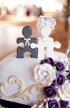 puzzle piece wedding topper! Or can use puzzle to symbolize perfect fit for name/seat cards or for somewhere at reception or part of favors. --if you're not picky about them looking like people, this is a cheap and easy craft with some paint and a scrap of lace.