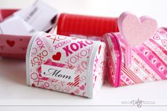 vdaymailboxes- fun to make  personalized mailboxes and a bowl of assorted compliments and love notes; the family can ppick notes and put them in the boxes for eachother secretly. Its a good cheap fun idea.
