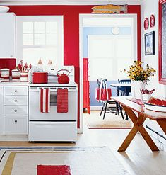 A kitchen with red w