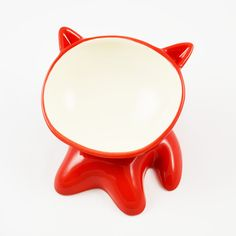 Are you making your cat work too hard for her dinner? Show her some WuvLuv by treating her to this eye-catching handmade ceramic bowl. Ergonomically designed, this feline food dish is elevated and tilted so little Whiskers can chow down with ease. You'll love the sassy design and the fact that each color is named for the cat that first tested the bowl (big thanks to Kung Fu!). In fact, why limit this punchy dish to the felines? This accessory also makes the purrfect candy dish.