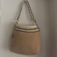"""The Sak bag 12""""x14"""" crocheted braided handle bag The Sak, bag two toned in natural colors. Along with a braid of mauve/light rose pink accenting the bag as well. Braided handled, attached by chrome  hardware hooks. Zipper closure, tons of room inside.  Zipper pocket & side pouches. The Sak Bags Shoulder Bags"""