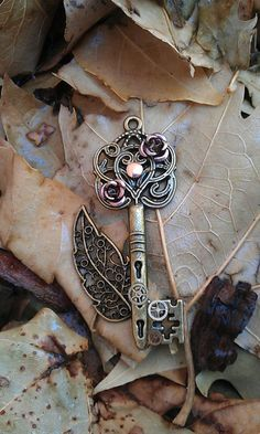 Mechanical Forest Key Pendant by DarkWolfJewelry on Etsy, $15.00- a little bit o' steampunk