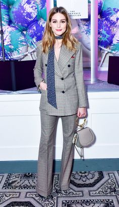 Olivia Palermo just wore a double breasted check suit by Chloé with a Nile bag and floral skinny scarf. Click here to shop her look.