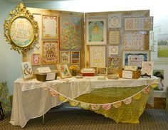 Having a booth? Ideas here: the assymetrical cloths, garland, ornate frame for the most important thing (AKA your logo!) and lots of pix of your consignment or resale shop, including of course, what it looks like as they come hinting for it! http://TGtbT.com is full of such ideas and tips!