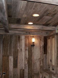 Actual barnwood on walls but faux painted beams