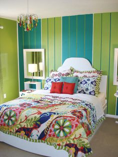 Bright Teen Bedroom--I like the colors of the stripes on the wall, but I wouldn't want to go to all that trouble to paint them.  The bedspread is way too busy for me, but the white headboard is great, and all the other white accents.  Maybe just a pillow made with the bedspread material?